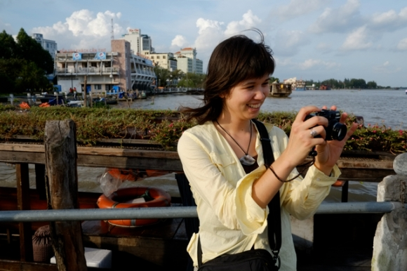Photographing a Mekong boat scene. Photo by Bao Quan Nguyen.
