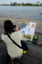 Photographing boat cargo on the Mekong. Photo by Bao Quan Nguyen.