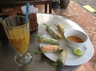 Passionfruit mango drink with veggie spring rolls. Delicious!